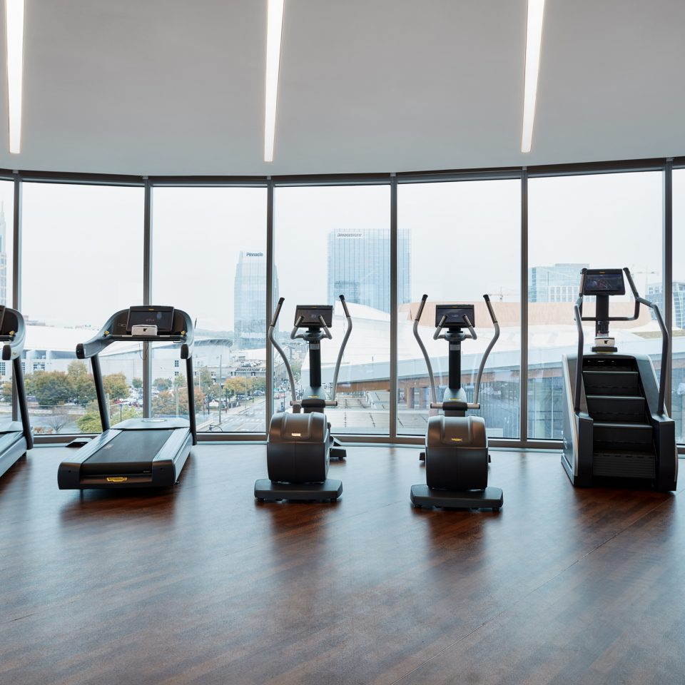 Fitness center with machines facing large wall windows