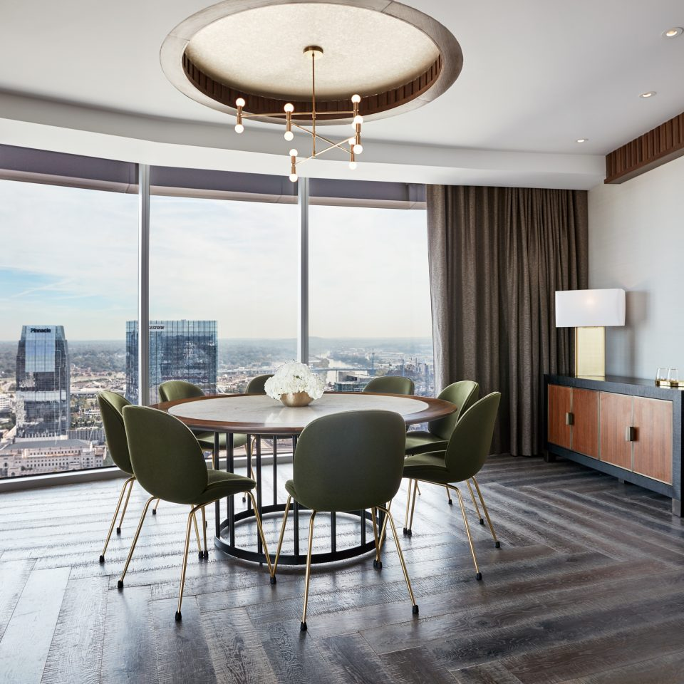 Presidential suite with large circle table next to large window