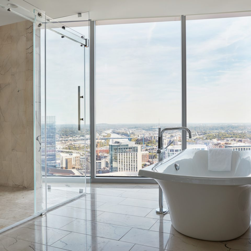 Presidential suite bathroom with large wall windows and large bathtub