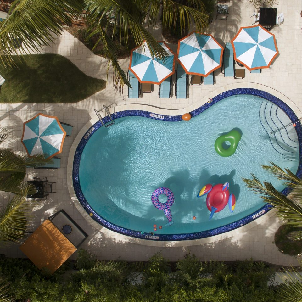 Overhead view of bean shaped pool with three floats in it