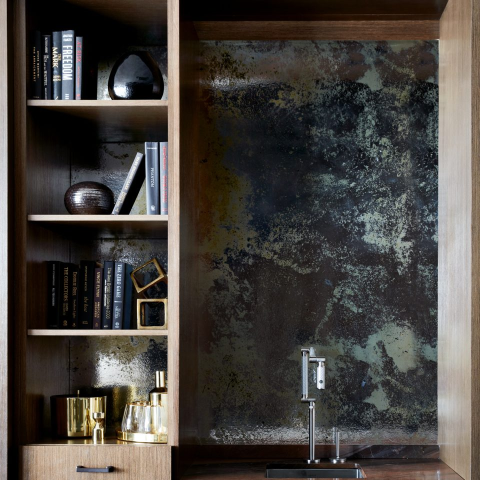 Sink with skinny library shelving next to it