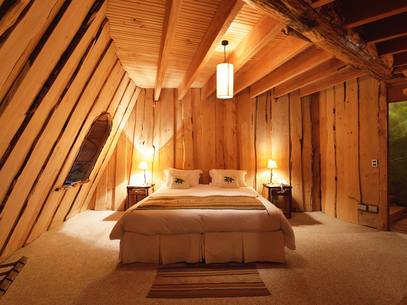 Wooden and warm room interior with queen sized bed
