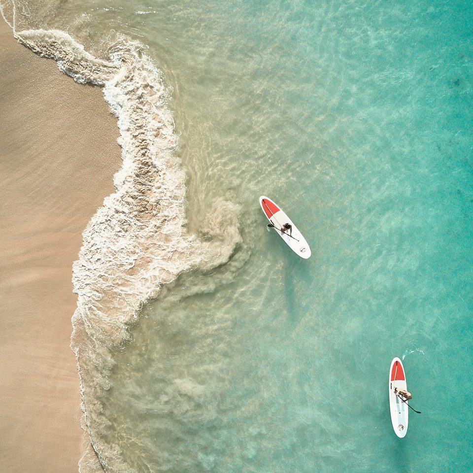 two people paddleboarding taken overhead
