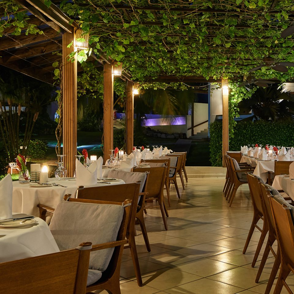 outdoor restaurant with numerous set tables