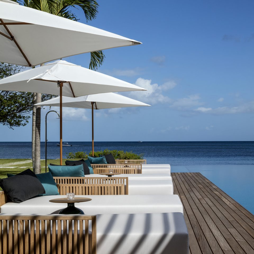 day beds next to infinity pool in the sun