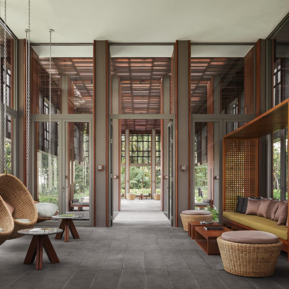 spacious lobby with hanging basket chairs and couches