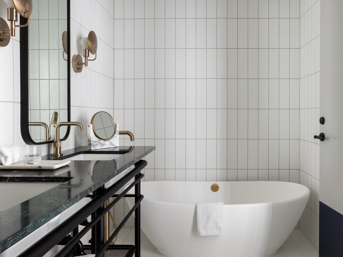White bathroom with a pretty bathtub