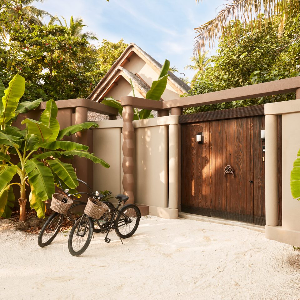 beach villa with two bicycles outside the entrance