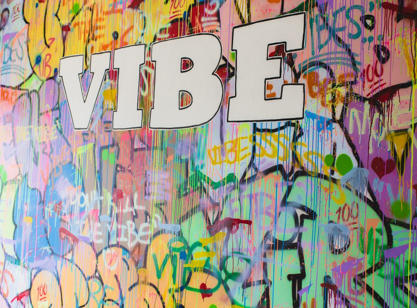"wall with graffiti saying ""Vibe"""