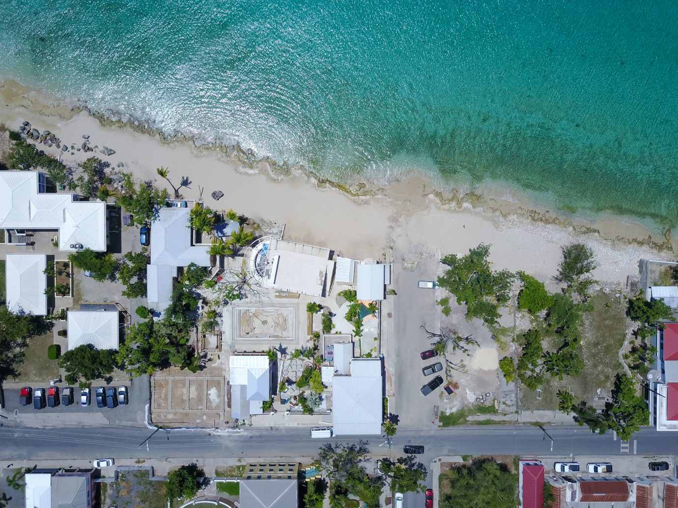 overhead view of the beach and hotel at The Fred