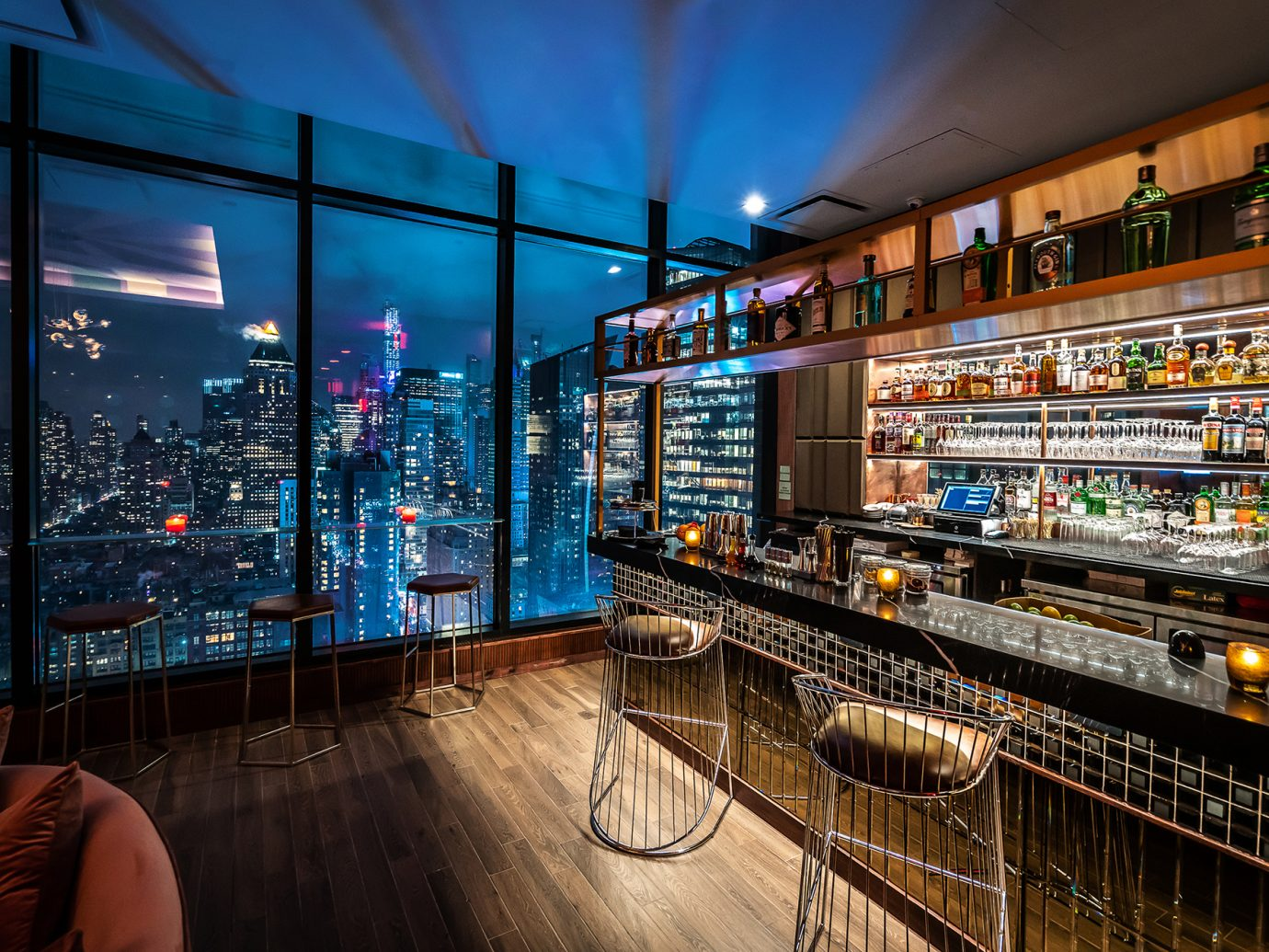 bar next to windows with NYC views