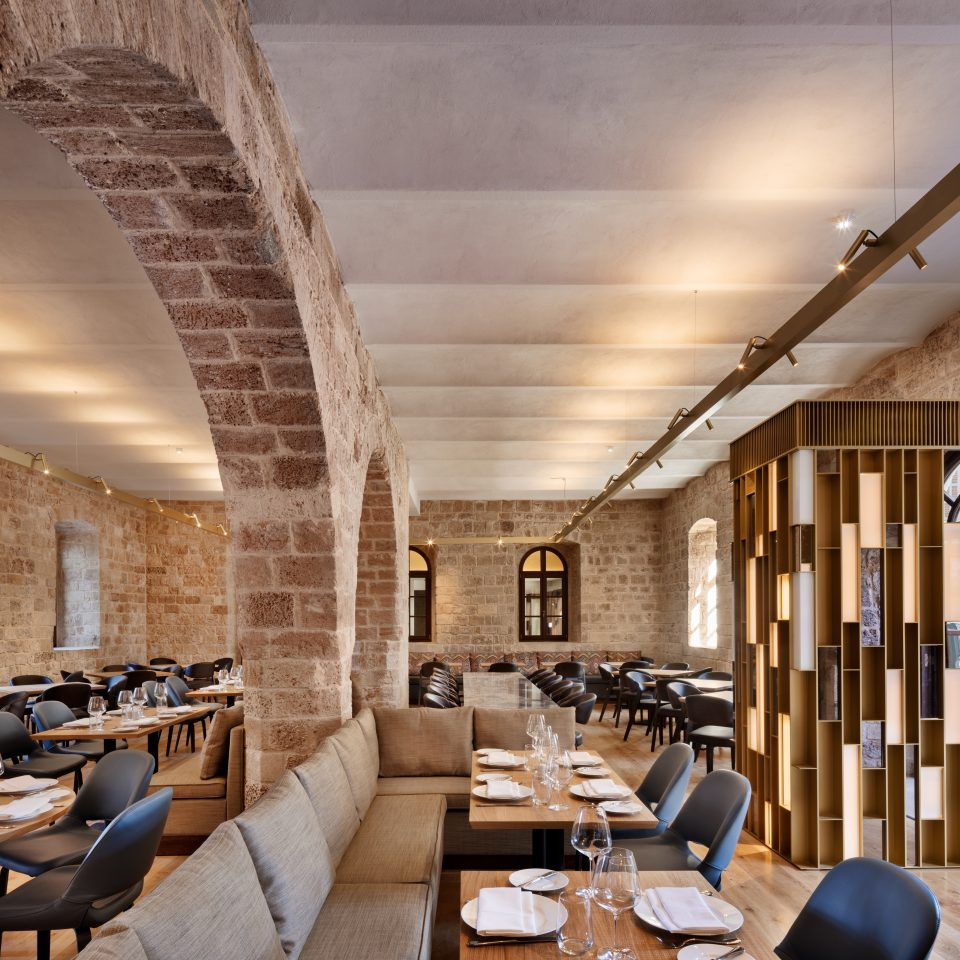 dining area showing exposed concrete light brick walls