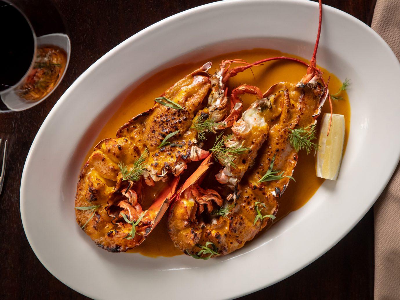 crustacean in an orange sauce