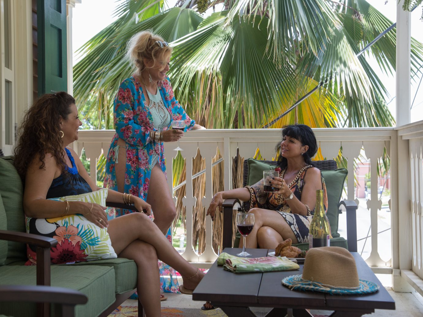 women chatting with eachother on a porch