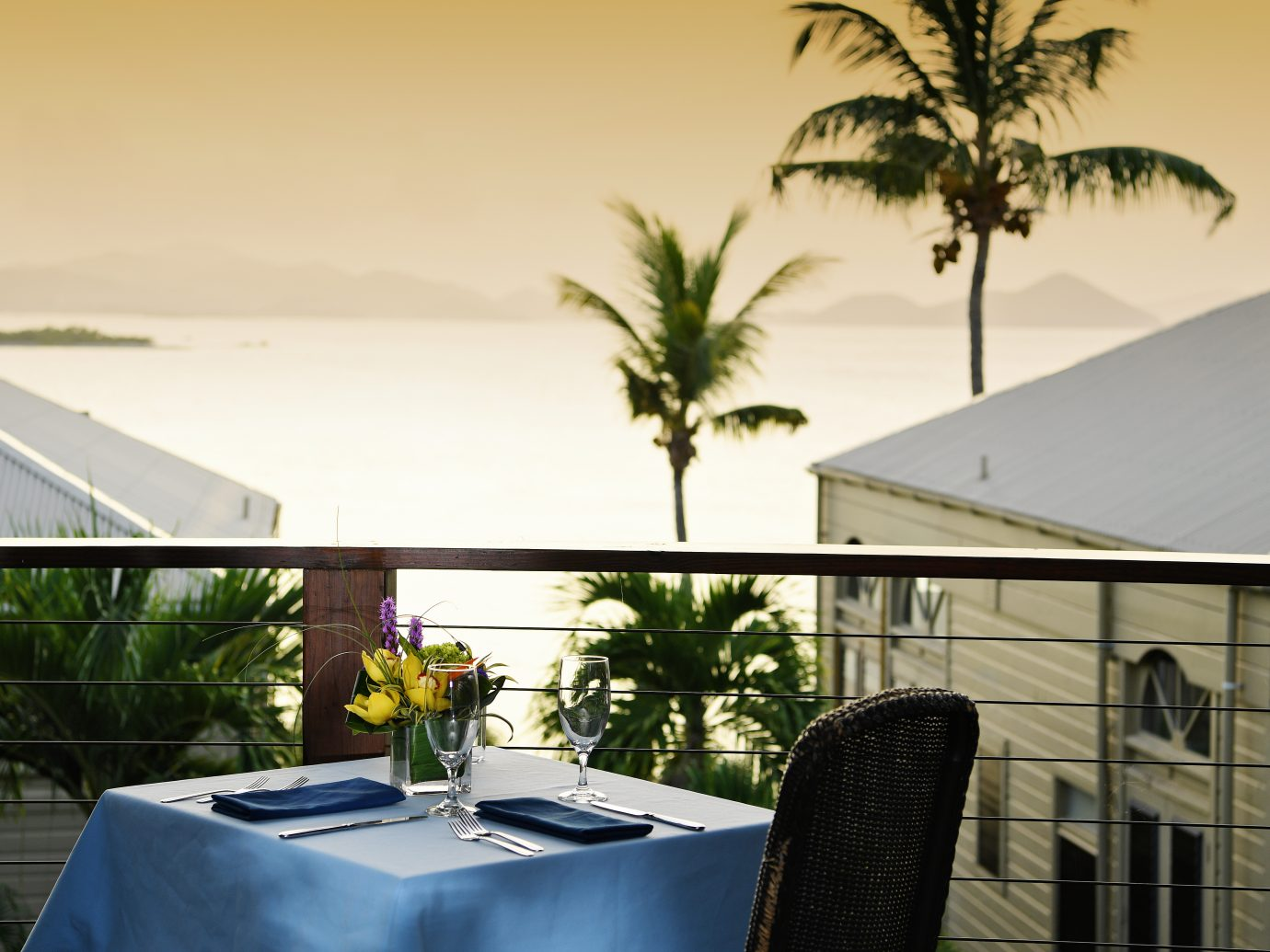 outdoor terrace eating looking at tropical scenery