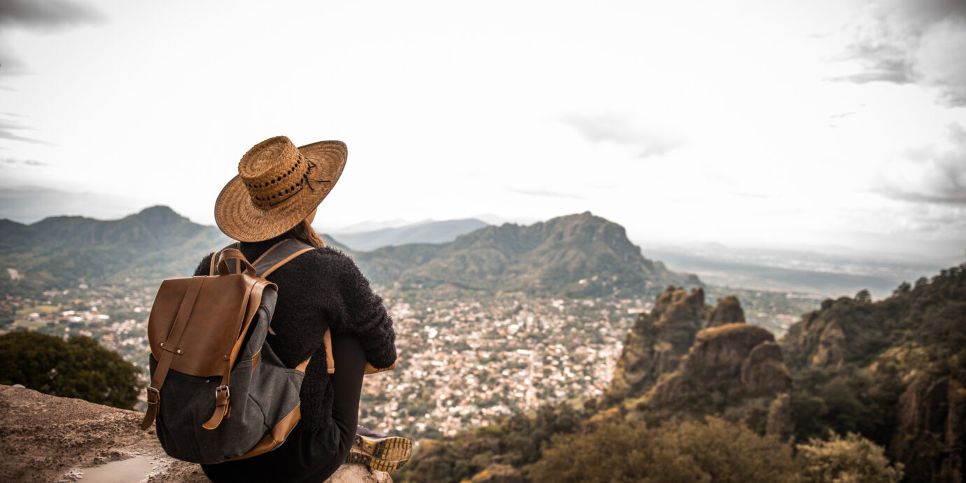 Woman traveling Mexico. She is enjoying the view on Tepoztlan, Mexico
