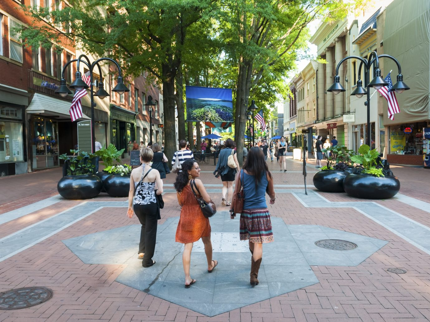 Charlottesville, Virginia, USA - June 7, 2012: Pedestrians enjoy a beautiful summer afternoon in downtown Charlottesville.