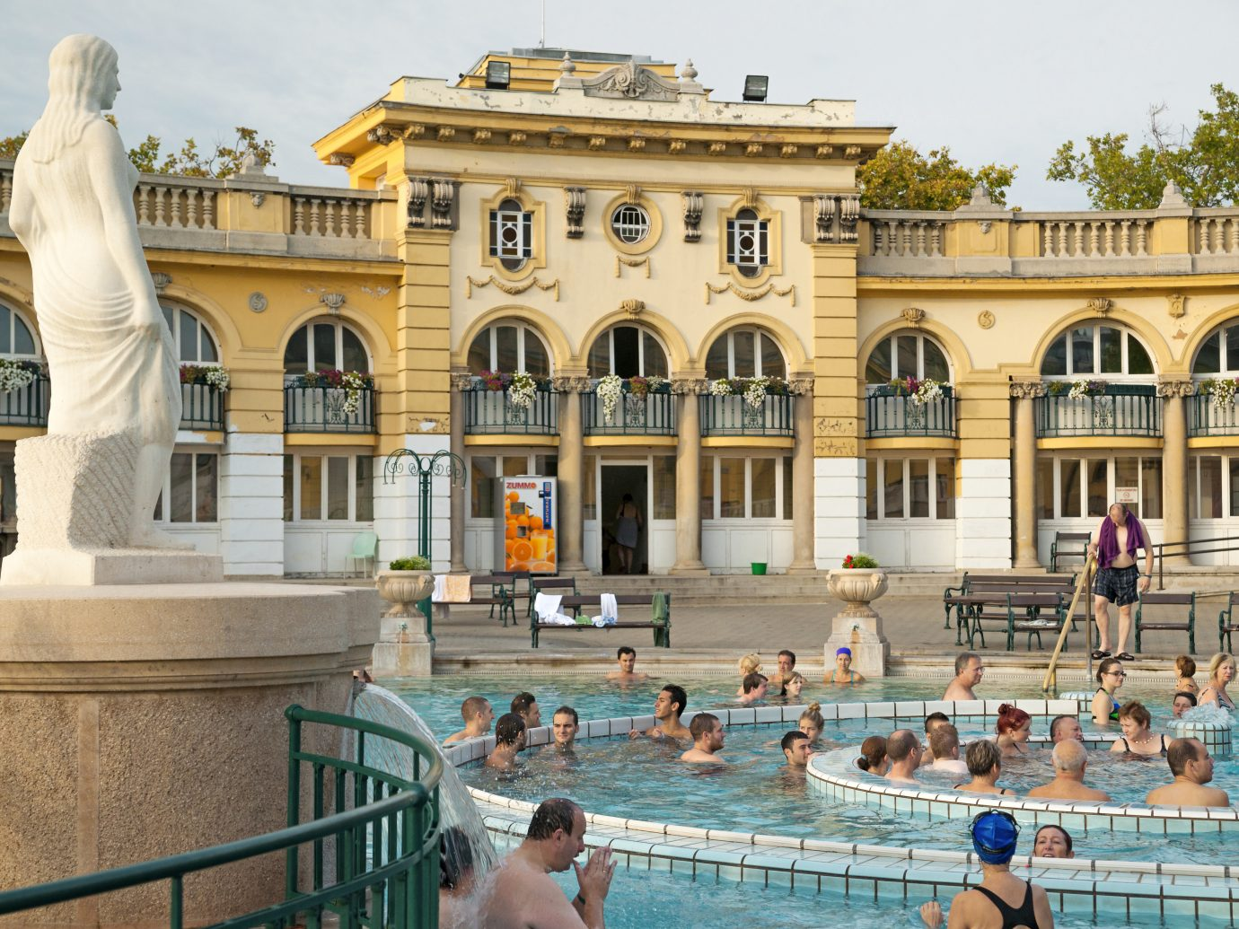 Bathers relaxing and soaking in healing mineral waters of Szechenyi Thermal Baths