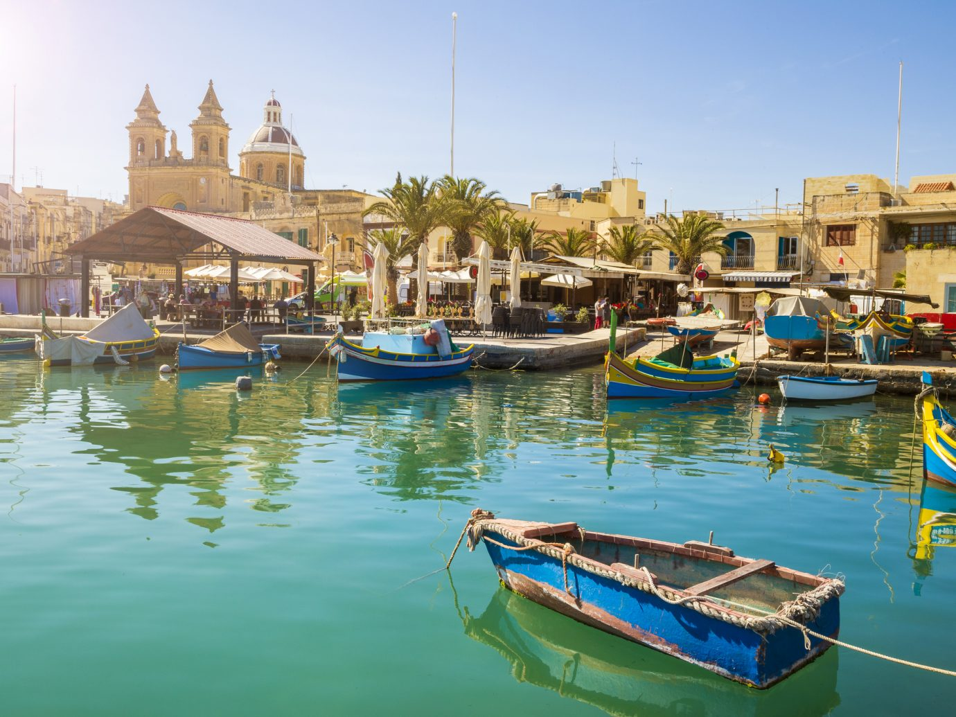 Malta - Marsaxlokk market with traditional colorful Luzzu fishing boats