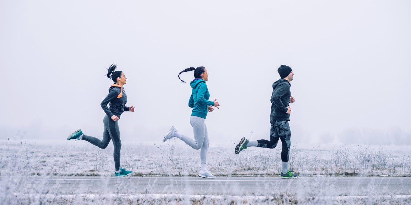 Photo of athlete people running outdoors in the winter.