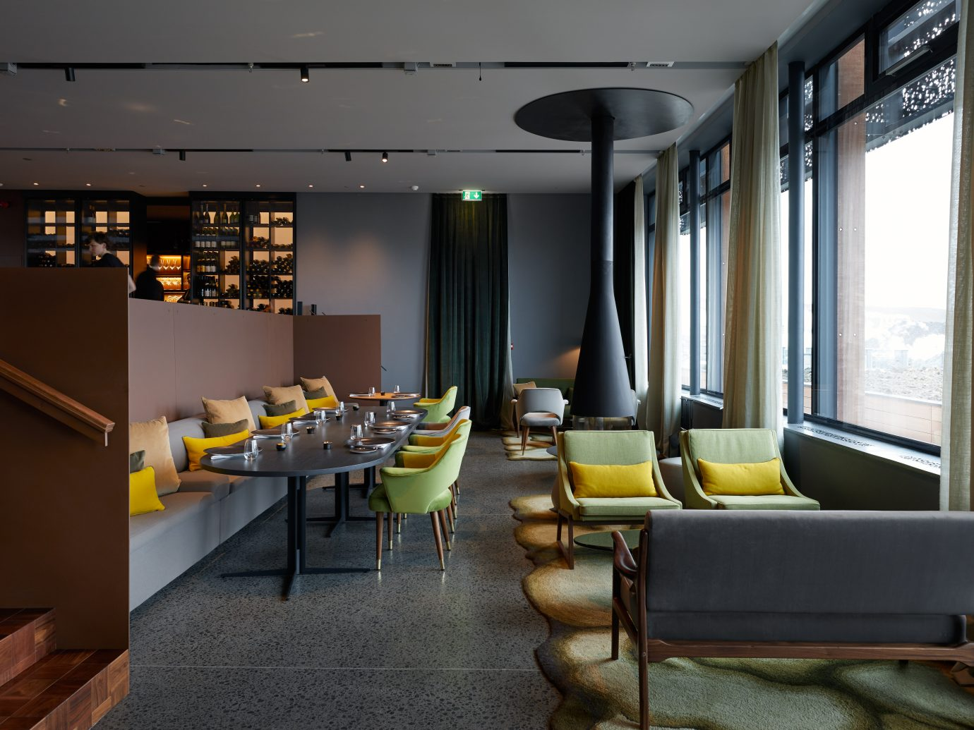 eating space with dark interior but funky colored furniture