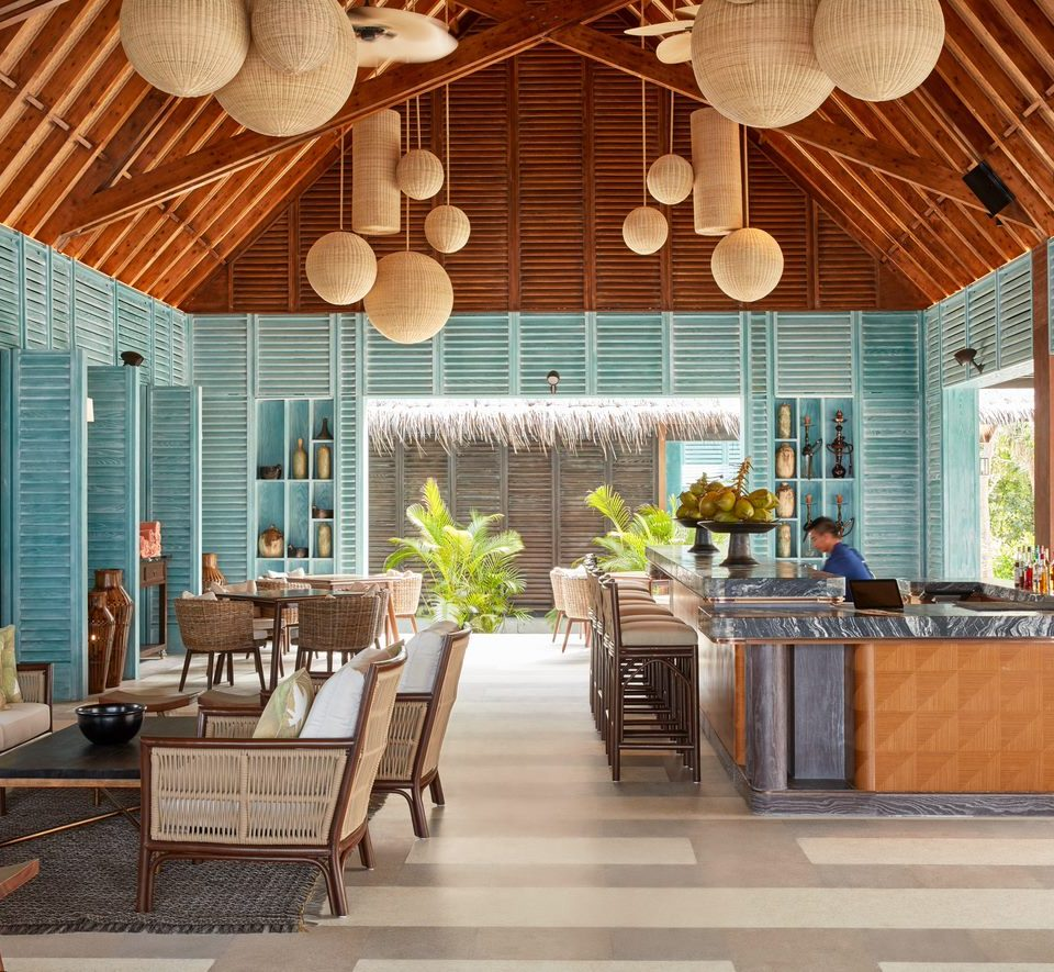 Mura bar with numerous lounge seating options and a tropical interior feel