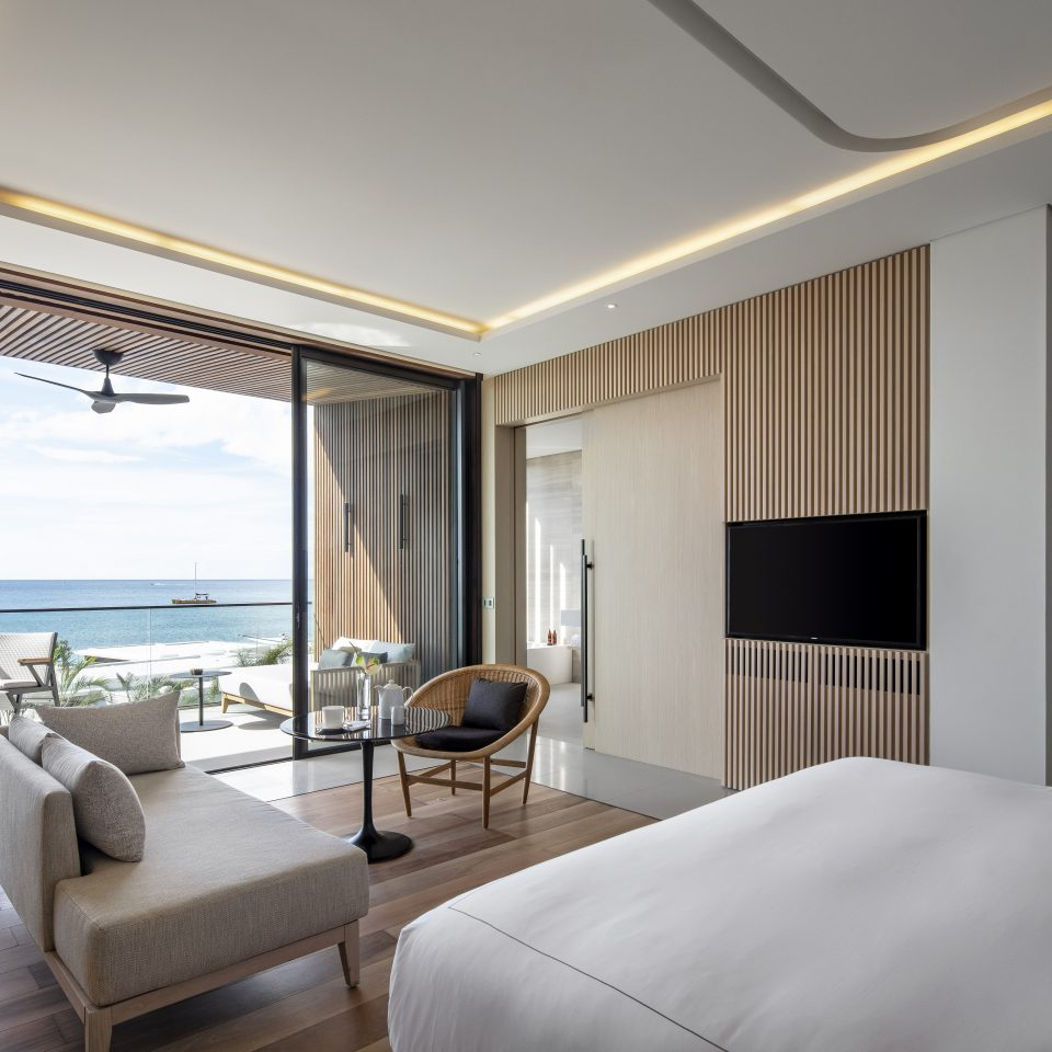penthouse with bedroom and private balcony looking at beach