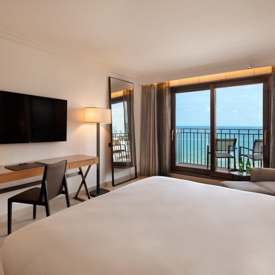premium plus room with a balcony that looks over blue waters