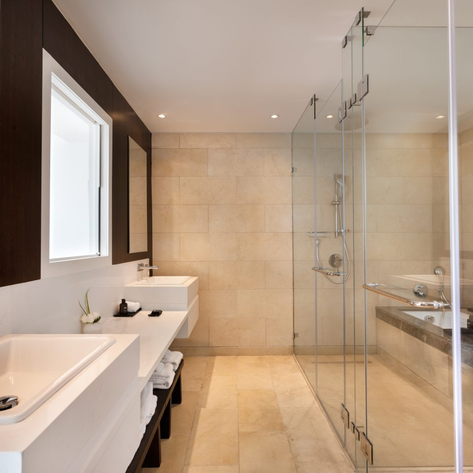 premium suite bathroom with two sinks and enormous shower