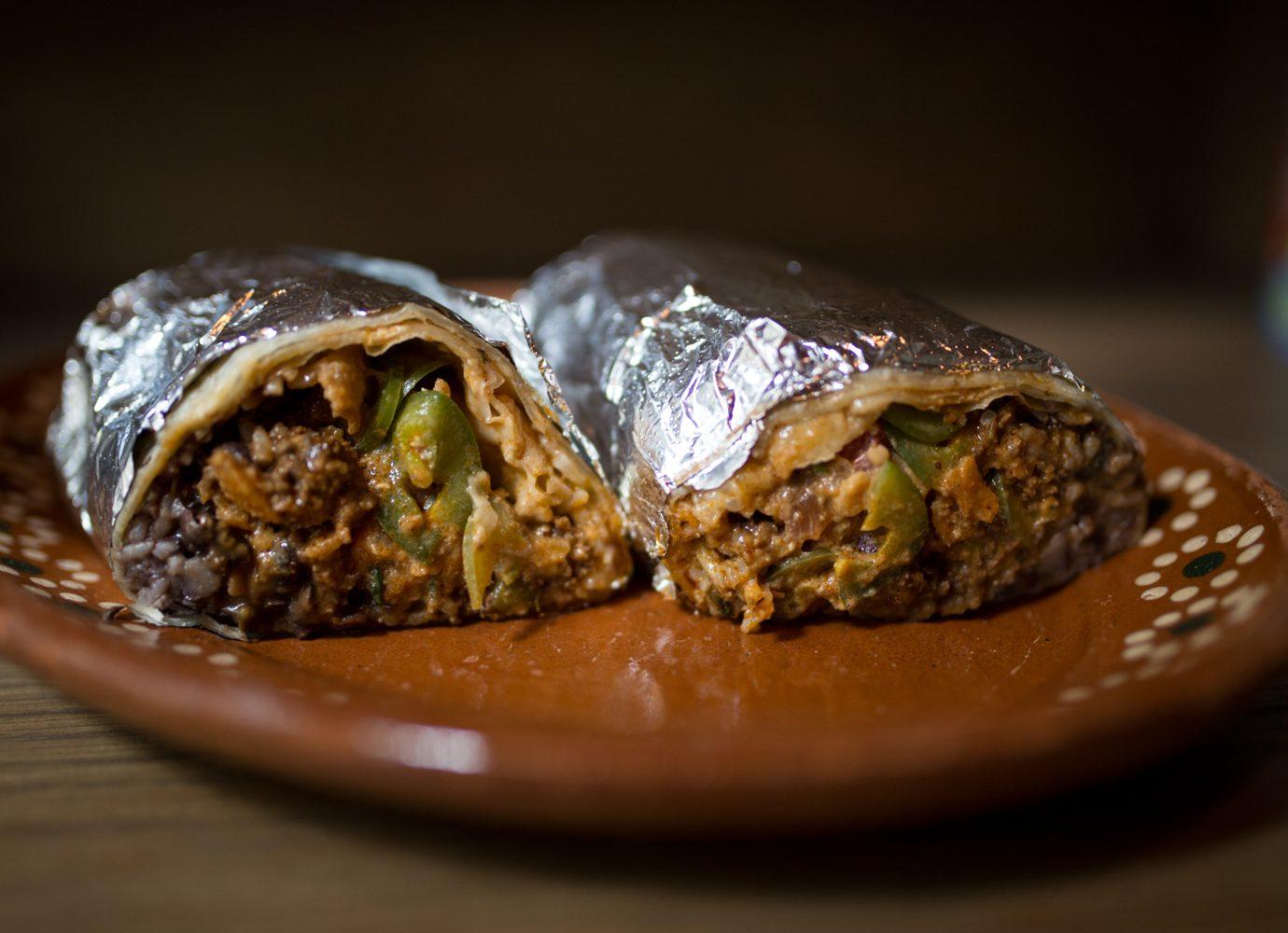 burrito cut in half wrapped in tin foil