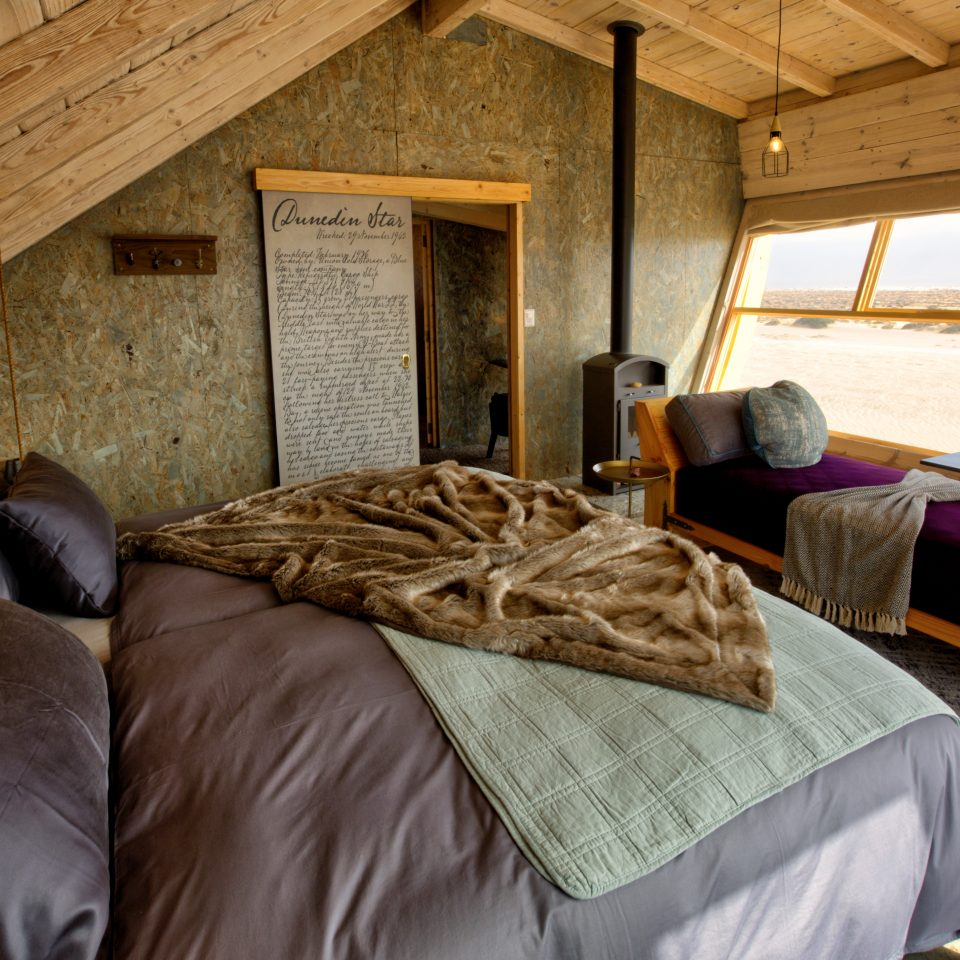 accommodations in Shipwreck Lodge showing bed