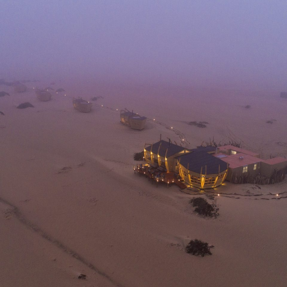 arial view of Shipwreck Lodge at dusk