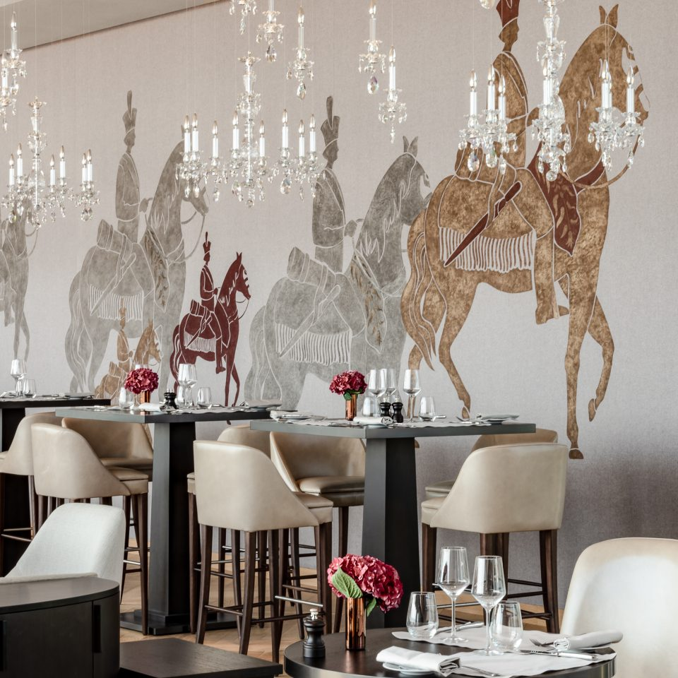 dining area with Renaissance-esque horses decoring the walls
