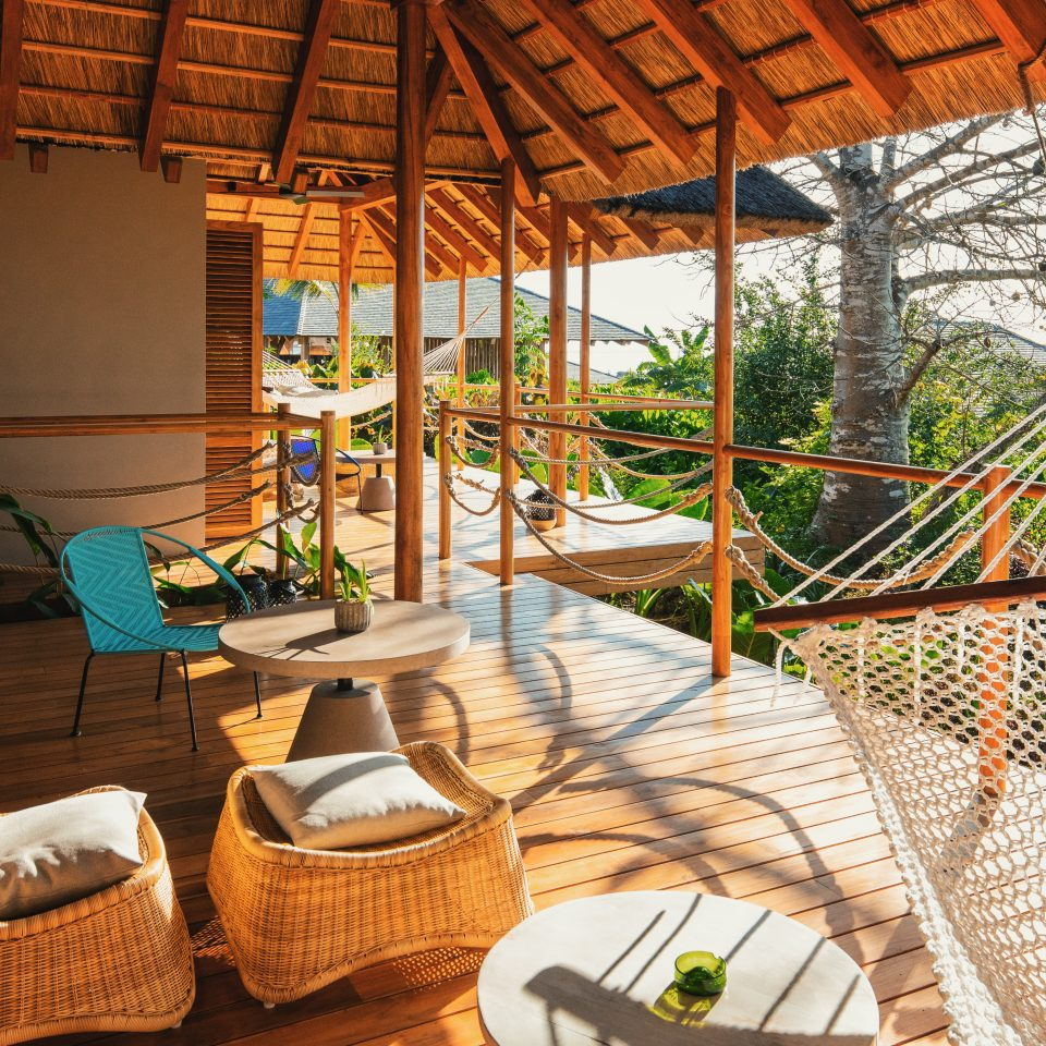 interconnecting porch spaces with numerous hammocks and seating options outside of hotel rooms