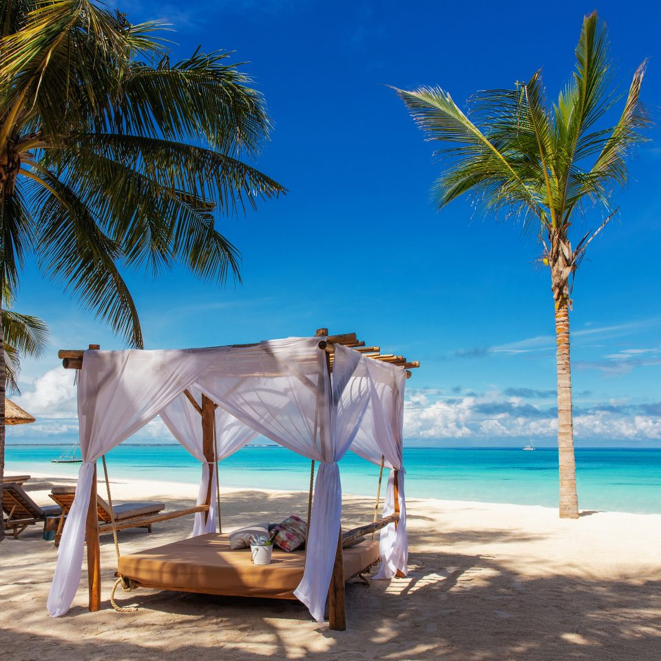 private beach with bed on it