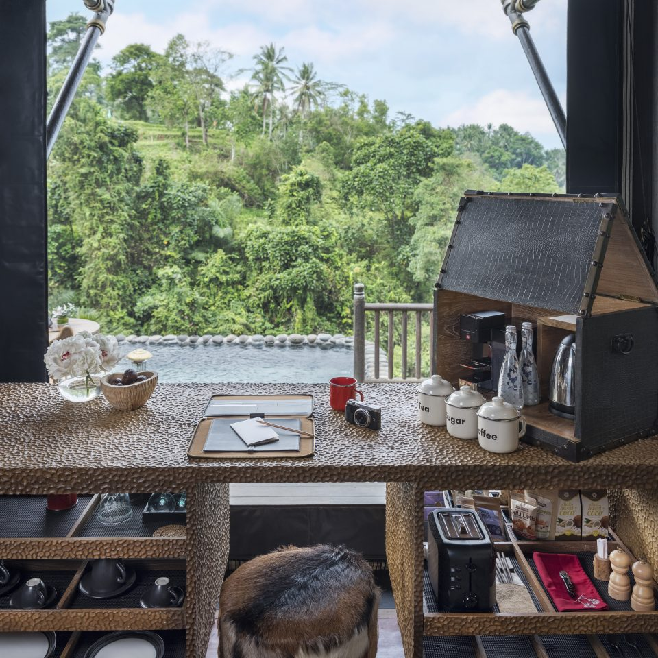 desk space in front of large window that looks over the jungle