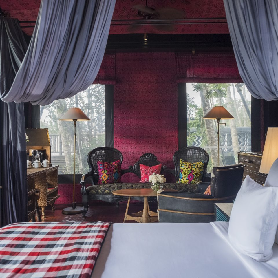 red interior of a room with draping curtains and beautiful furnishing