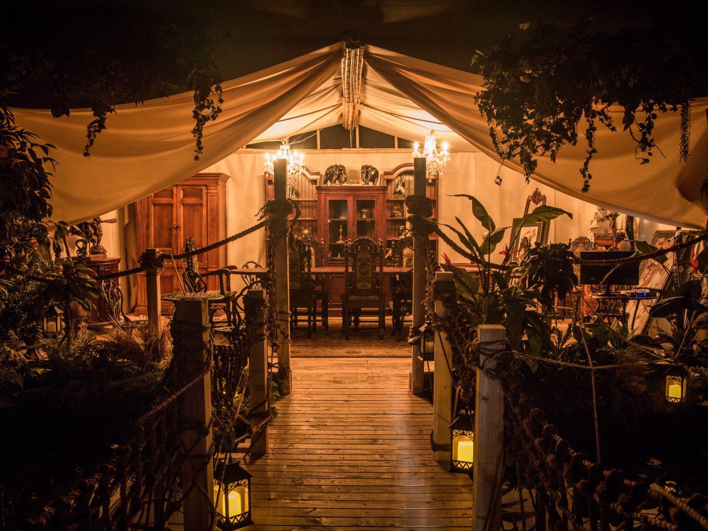 tent area exterior at Lost Spirits Distillery at night