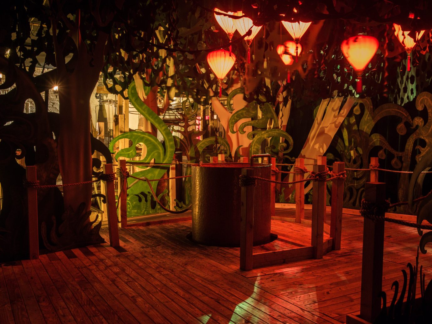 red lit forrest looking room at Lost Spirits Distillery