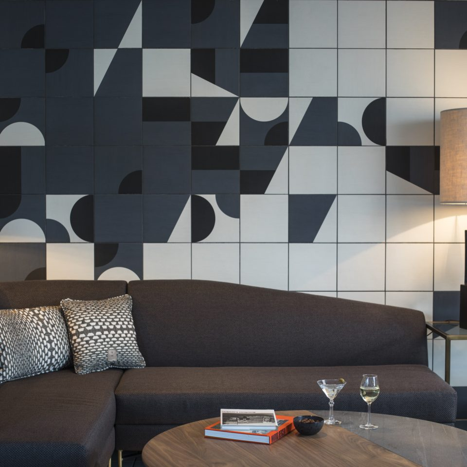 couch with interesting wall tile design