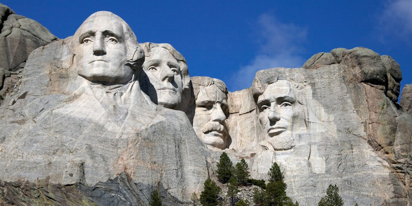 Best Presidents Day Sales 2019, Close up view of Mount Rushmore under a blue sky