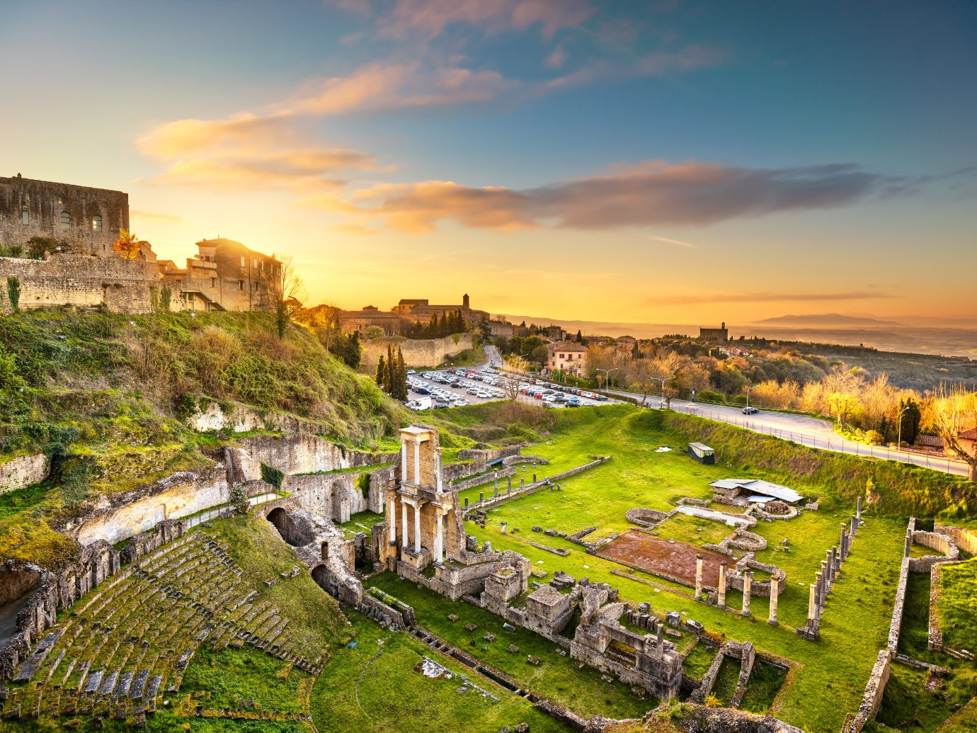 Volterra, roman theatre ruins at sunset.