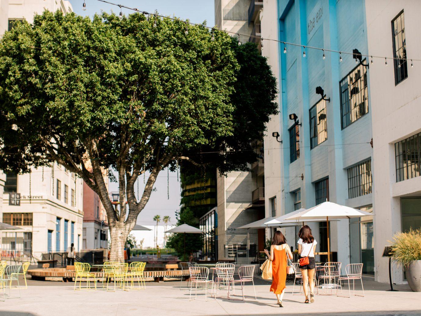 two women walking toward tree in ROW DTLA