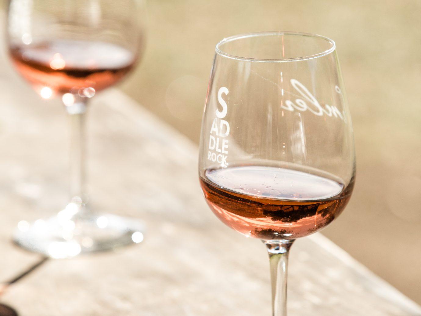 rose in wine glasses outside