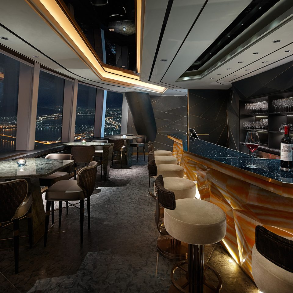 indoor bar with view of outside at night on high floor