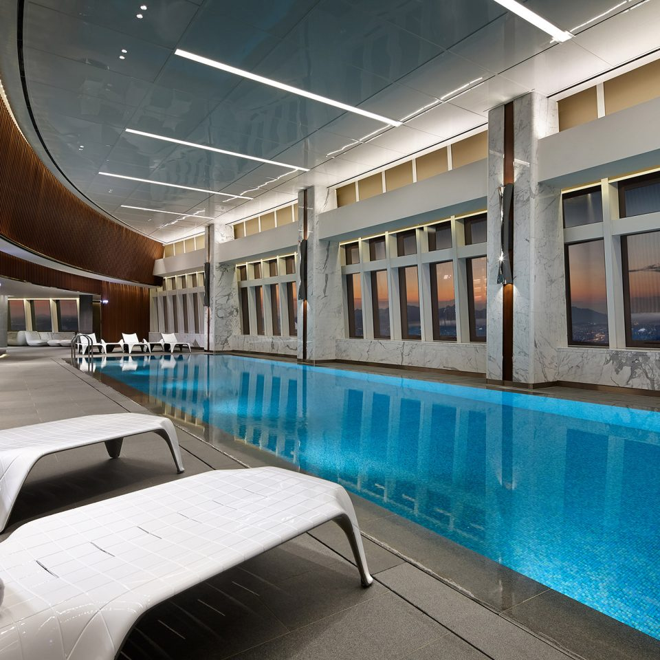 indoor upper level pool as sun sets