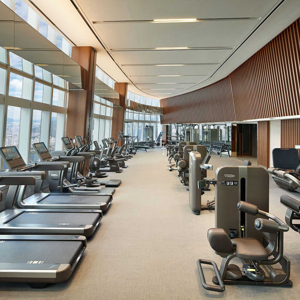 indoor gym on very high floor with view of city
