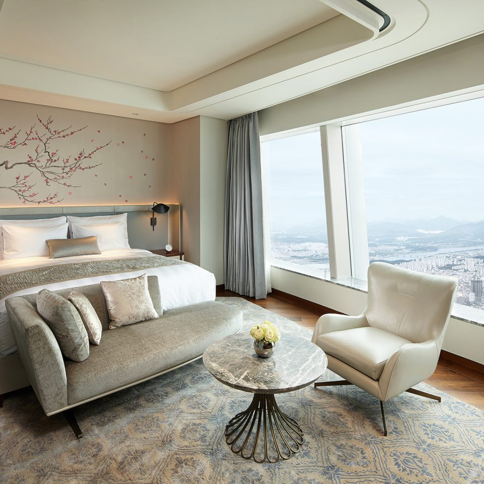 seating area with city view in suite in day time