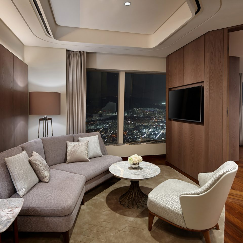 deluxe suite seating area with TV