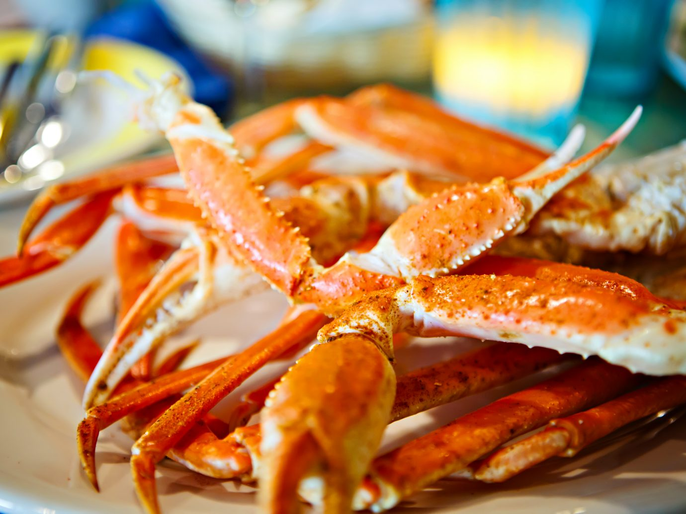 Plate with crab legs in a restaurant in Key West or New Orleans. Tasty delicious seafood.